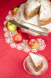 Applesauce raisin rum cake for christmas table. Table decorated with lacy napkin. From series of Merry Christmas Stock Photos