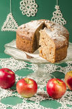 Applesauce raisin rum cake for christmas table. Table decorated with lacy snowflakes and napkin. From series of Merry Christmas Stock Photography