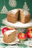 Applesauce raisin rum cake for christmas table. Table decorated with lacy snowflakes and napkin. From series of Merry Christmas Royalty Free Stock Images