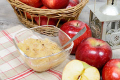 Applesauce with some apples. In the background royalty free stock image