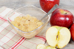 Applesauce with some apples. In the background Royalty Free Stock Photography