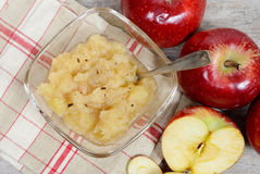 Applesauce with some apples. In the background Stock Photography