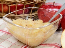 Applesauce with some apples Stock Images