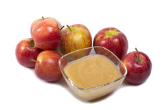 Applesauce on white background. Applesauce with whole apples goshawks Stock Photography