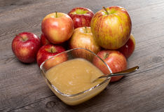 Applesauce on a wooden table. With apples Stock Image