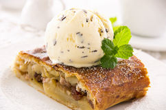 Applestrudel with Ice Cream. Applestrudel with vanilla ice cream as closeup on a white plate Stock Image