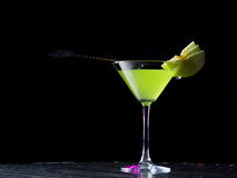 Appletini cocktail with apples slices Royalty Free Stock Images