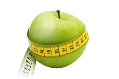 Appleweight/path. Green Apple with measuring tape Royalty Free Stock Photos
