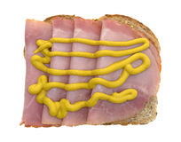 Applewood smoked ham with mustard on bread Royalty Free Stock Images