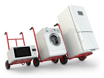 Appliance delivery. Hand truck, fridge, washing machine and micr. Owave oven. 3d Royalty Free Stock Photography