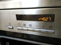 Appliance front panel. Front panel of a stainless steel cooker with electronic timer Royalty Free Stock Photography