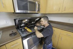 Appliance Technician Checking His Meter Stock Photo