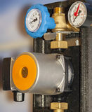 Appliances hot and cold water. Water pump, thermometers, hot and cold water pipes are installed on Stock Photo