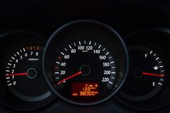 Appliances indications of automobile dashboard. On dark background royalty free stock image