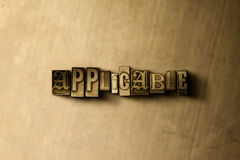 APPLICABLE - close-up of grungy vintage typeset word on metal backdrop. Royalty free stock illustration.  Can be used for online banner ads and direct mail Stock Photo