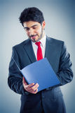 Applicant with blue application folder. Applicant ist holding application blue application folder Royalty Free Stock Image