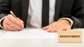 Applicant completing a job application Royalty Free Stock Photo