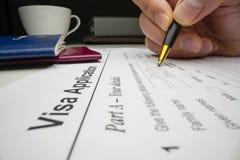 Applicant completing visa application form