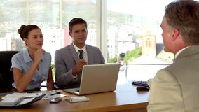 Applicant having a job interview in front of business people stock footage