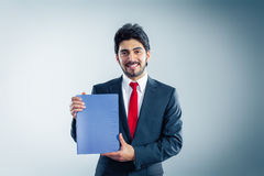 Applicant is holding application. Candidate is holding a blue application folder copyspace Stock Photo