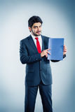 Applicant is holding application. Candidate is holding a blue application folder copyspace Stock Photos