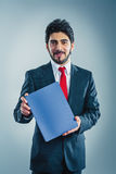 Applicant is holding application folder. Applicant is holding application blue application folder Stock Photography