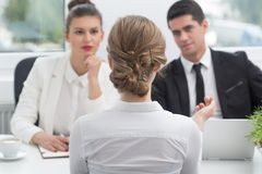 Applicant and recruitment procedure. Young women and recruitment procedure in corporation Royalty Free Stock Photos