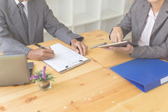 Applicant& x27;s hand holding ballpoint pen writing on empty applicat Royalty Free Stock Photos