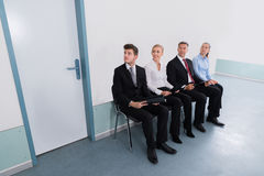 Applicants Sitting On Chair In Office Royalty Free Stock Photos