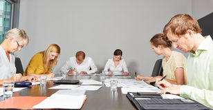 Application candidates in assessment center. Filling out test forms Stock Photo
