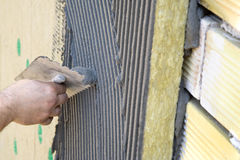 Application of coating over insulation Royalty Free Stock Images