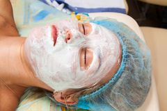Application of a cosmetic mask on the face Royalty Free Stock Photography