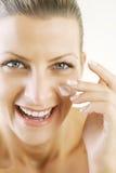 Application de la visage-crème Photo libre de droits