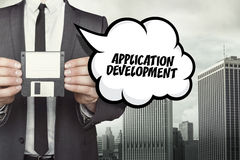 Application Development text on speech bubble with businessman Royalty Free Stock Photo