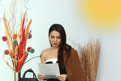 Application document for Job interview, in modern offic room. Asian Beautiful woman black hair read report and application document for Job interview, in modern stock photos