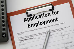 Application for Employment. Job application form in a file on the office desk Royalty Free Stock Photos