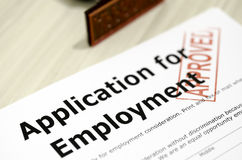 Application for Employment. Shot in the corner of the stamp approved job application form Royalty Free Stock Photos
