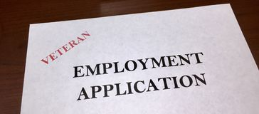 Veteran Employment Application. A application for employment that has been stamped to let the employer know that it is a veteran that is applying for a position royalty free stock image