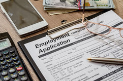 Application for employment with money, calculator, pen Royalty Free Stock Photography
