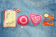 Application on a fabric. LOVE  can be used as a background Royalty Free Stock Photo