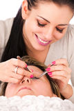 Application of false eyelashes Royalty Free Stock Image