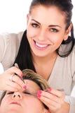 Application of false eyelashes Royalty Free Stock Images
