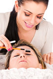 Application of false eyelashes Royalty Free Stock Photography