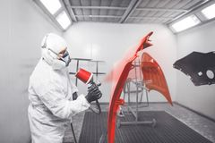 Application of first layer spray painting of the car details. royalty free stock image