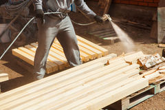 Application of flame retardant ensuring fire protection, airless spraying device. Royalty Free Stock Photos