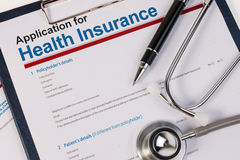 Application form for health insurance. Application form for health insurance, paperwork, questionnaire with pen and stethoscope. Health insurance claim concept Stock Photos