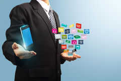 Application icon with mobile phone in the hands Stock Photos