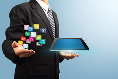 Application icon with tablet computer in the hands Stock Photography