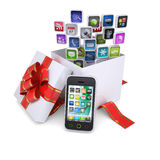 Application icons of the gift box next to the smartphone Royalty Free Stock Image