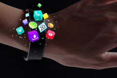 Application icons on smart wristband. Stock Photography